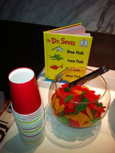 I like how the swedish fish are placed in a fish bowl. The idea of the food and corresponding book would work for either a dessert option or for a table centerpiece.