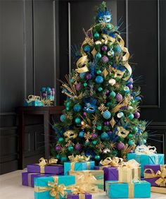6ft/180cm Deluxe Tree & Tree Decorations Like this but with a real tree gotta have the pine scent and needles dropping everywhere, also last year we got a bonus birdie nest for free.
