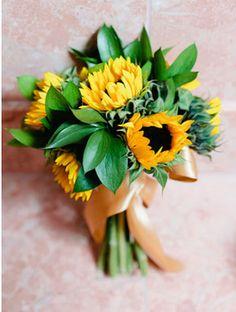 Sunflower Wedding Bouquet. Read more: http://memorablewedding.blogspot.com/2013/12/sunflower-wedding-theme.html