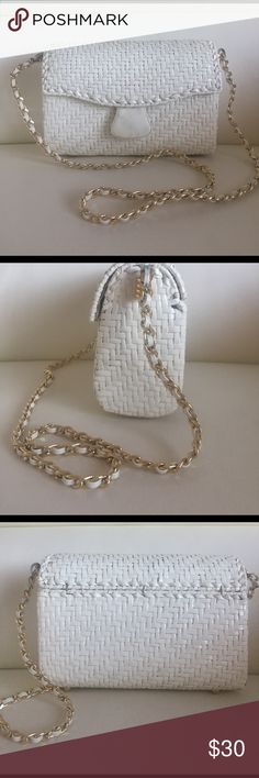 White woven leather shoulder bag White woven leather Italian shoulder bag. Strap is gold chain with white leather interwoven in it. In good condition. Bags Shoulder Bags