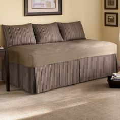 Love how they made a twin size bed look like a couch- Could I sew a cover like…