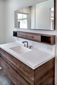 Walnut Floating Vanity and Medicine Cabinet designed, built, and installed by Bill Fry Construction finished with Rubio Monocoat and casework made of Purebond Plywood from Columbia Forest Products.