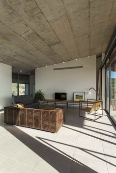 Living room with concrete ceilings