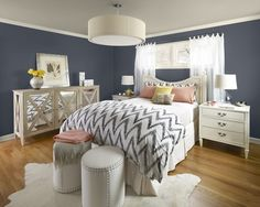 Beautiful wall color with white timr. Would like better with all white bedding and just a touch of the blue/gray.