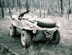 A black and white photo of a restored VW Type 166 Schwimmwagen