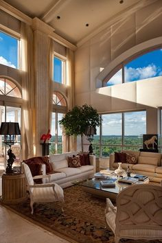 We love the way the designer made the #windows the focus of this #living space. Gorgeous!