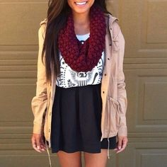 High-waisted skirt, jacket, tee, and scarf.