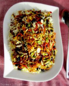 Javaher Polow - Persian Jeweled Rice - Sharon T - Javaher Polow - Persian Jeweled Rice جواهرپلو Javaher Polow (jeweled rice) is a traditional rice dish for weddings, engagement parties and other joyous celebrations. I tho. Rice Recipes, Indian Food Recipes, Vegetarian Recipes, Cooking Recipes, Healthy Recipes, Ethnic Recipes, Dessert Recipes, Dessert Food, Iranian Cuisine