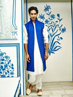 This ink blue textured open sherwani is not only stylish but also vey versitile. Team it with a traditional kurta inside and a fun salwar or a more traditional dhoti below and it's the perfect sangeet look!