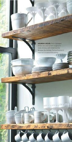 Barn wood or rustic shelving with black hardware for extra storage in kitchen. Small kitchens