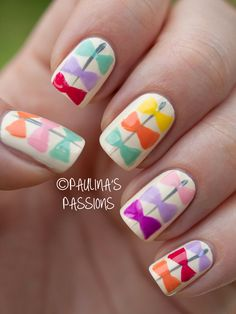Colorful Bow Nail Art. Maybe just one or 2 nails though.