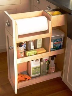 """Top-Down Organization """"Stock a kitchen pullout drawer based on supplies you'll need most while cleaning. Position often-used towels, scrubbers, and cleaning agents on higher shelves for easy access. Stash seldom-used items lower to keep them within reach Kitchen Pull Out Drawers, Kitchen Cabinet Organization, Storage Cabinets, Kitchen Storage, Home Organization, Organizing Ideas, Pantry Storage, Storage Shelves, Base Cabinets"""