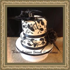 A classic beautiful black and white vintage style occasion or wedding cake .