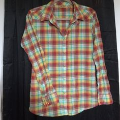 Shimmer Plaid Western Shirt Literally one of the coolest shirts I've ever owned. Glitter thread, with sparkle snap buttons & a sweeet back design. Most people can't handle the awesomeness of this rootin tootin shirt. Wrangler Tops Button Down Shirts
