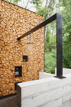 outdoor shower - chopped wood wall, modern metal