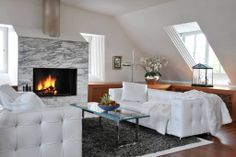 Penthouse VIP Suite of the Luxury Widder Hotel Zurich in designer white leather and fireplace.