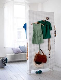 Using Pegboard: A Small Space Solution for Every Room: Double sided pegboard on wheels - room divider & storage / Apartment Therapy