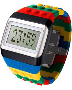 JC/DC Pop Hours watch from JC de Castelbajac inspired by his love of Lego. Invisible buttons are touch-sensitive LED display can be set to scroll the date, time and a message. Comes in a Rubik's cube inspired box.