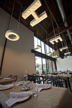 HELLO. Contemporary chandeleir with quirk at Seattle's The Whale Wins [Restaurant] | Heliotrope Architects