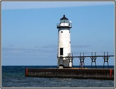 Manistee North Pier, Michigan. I have spent many summers here. We need to go back this summer to take another family photo.