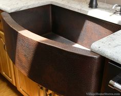 Hammered copper farm sink. | VillageHomeStores.com