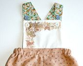 Vintage style sunsuit handmade with up-cycled and reclaimed fabrics.    This garment features;    ~ Peach cotton shorts  ~ Up-cycled vintage napkin bib with natural cotton backing  ~ Up-cycled floral straps  ~ Snap crotch and adjustable buttoned straps This listing is for size 6-12mths (8-10kg / 17-22lbs)    Other sizes available;    1T  https://www.etsy.com/listing/106756948/girls-vintage-sunsuit-size-1t