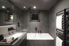 grey bathroom tiles and matching wall paint - Fiona Barratt Interiors