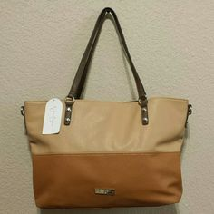 NWT! Jessica Simpson Getaway Color Block Tote This sand and henna colorblock Jessica Simpson Getaway tote bag features a roomy main compartment with one zipper interior and 2 open interior pockets. This bag has two top handles and a detachable shoulder strap for easy carrying. Magnetic top closure with silvertone hardware.   Bag dimensions: 14 inches long x 6 inches wide x 14.5 inches high Drop: 9 inches  Additional shoulder strap drop: 19 inches Jessica Simpson Bags Totes
