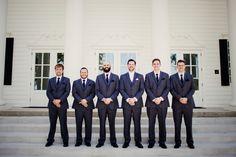 groomsmen outside The Milestone Aubrey