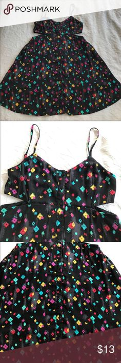 NWOT 🎉Black pattern button up cutout dress Black patterned button up dress. The dress has cutouts on the ribs. The dress is lined. PacSun Dresses Mini