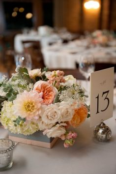 Soft and romantic wedding centerpiece | photography by http://www.alainabos.com/