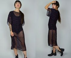 Gorgeous 1970s sheer dress. Made in a silky black polyester material. Small…