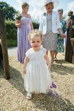 Flower Girl White Dress Country Marquee Wedding https://www.fullerphotographyweddings.co.uk/