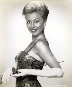 Mitzi Gaynor, 1959. - Partial Filmography:  For Love or Money (7-Aug-1963)       Surprise Package (29-Sep-1960)       Happy Anniversary (10-Nov-1959)       South Pacific (19-Mar-1958)       Les Girls (3-Oct-1957) · Joy Henderson      The Joker Is Wild (26-Sep-1957) · Martha Stewart      The Birds and the Bees (22-Apr-1956)       Anything Goes (Apr-1956)       There's No Business Like Show Business (16-Dec-1954) · Katy Donahue      Three Young Texans (Jan-1954)
