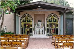 Wedding in San Juan Capistrano at the El Adobe De Capistrano restaurant. Ceremony site was decorated in teal and tan details with chunky candle sticks and burlap flag signs, and baby's breath flowers. Gypsophila