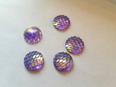 Check out this item in my Etsy shop https://www.etsy.com/listing/464721338/purple-scale-cabochon-cabochon-flatback
