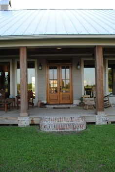 Using Cypress Beams Indigenous to Southern Louisiana to Create the Desired Welcoming Entrance, Porch Overlooks Residence's Front Yard Fishing Pond
