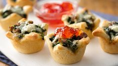 Sausage and Blue Cheese Crescent Cups, from Pillsbury. Made with crescent dough, sausage, blue cheese, and red pepper jelly.