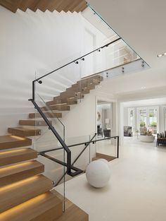 """Custom Wood Glass and Steel Staircase 