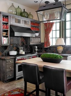 The kitchen design in a house that is quite rustic, huntsy, & with an old-world feel. Kitchen counters seem to be quite low.