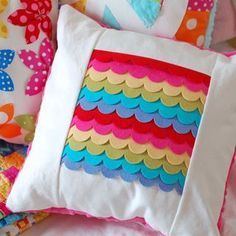 DIY for felt scallop pillow ... http://scrapbookgirl.typepad.com/paper_scissors_and_superh/2010/12/at-home-with-papertrey.html#