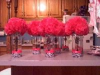 """I think we could make these pom flowers and attach to a styrafoam ball. Tissue paper pomander balls.  larger ones (5"""" styro ball) with clear """"diamond"""" pins throughout smaller"""