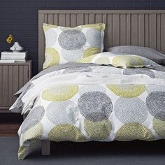 Dotty circles spin across this duvet cover on crisp, 250-thread count cotton percale in a quirky palette of gray, bark and spring green.