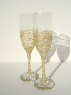 Hand decorated wedding champagne glasses in gold, set of 2 toasting flutes for your wedding reception or as a gift on Etsy, $52.00