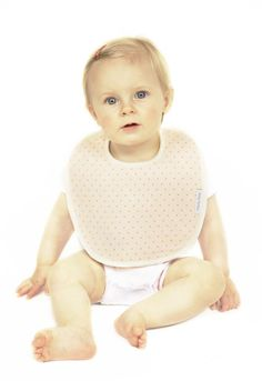 Hello Charlie - Baby Teresa Organic Cotton Bib - Ruby Pink Spot, $8.95. A company with a conscience...a part of the profits from each bib goes towards buying formula for a baby in need.  (http://www.hellocharlie.com.au/baby-teresa-organic-cotton-bib-ruby-pink-spot/)