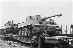 Tiger 1 tanks being secured to heavy duty flat cars for transport