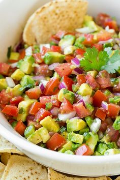 Avocado Salsa - this is so good you'll want to just ditch the chips and eat it by the spoonful! I couldn't stop eating it.