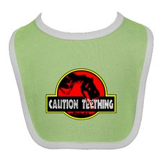 Even dinosaurs get a little cranky. This dinosaur in a parody of the Jurassic Park logo decided to use the letters as pain relief for his teeth! Caution Teething! Baby Bibs $9.99 www.inktastic.com