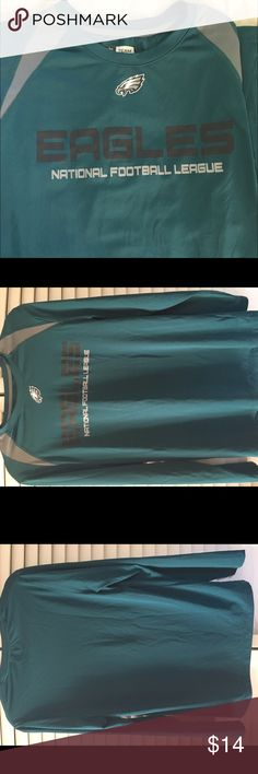 Men's NFL Apparel Philadelphia Eagles silky shirtM Here's one for the Eagles fans!  Beautiful, pre-loved condition long sleeve polyester (Under Armour material-like) teal shirt with black and gray lettering.  Features the Eagles logo right up top, and gray insets leading to the collar. This is perfect for a first layer at chilly games, or by itself in warmer weather. Smoke-free and ready for your closet. NFL Apparel Shirts Tees - Long Sleeve