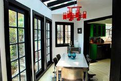love the dark wood trim against white walls